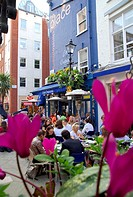 Tourists sitting at restaurant, St. Christophers Place, London, England