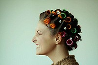 Woman with curler, side view