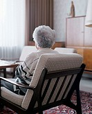 Senior woman sitting in chair, rear view