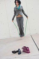 Businesswoman skipping with a jump rope