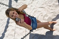 High angle view of a young woman holding a mobile phone