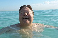 Portrait of a mature man swimming in the sea