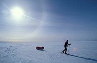 A polar traveler walking across the Antarctic ice cap, at only 80 miles from the geographic South Pole, 90 degrees North, near the American Amundsen-S...