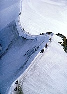 Mountaineers walking on ridge in the French Alps