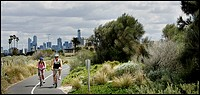 Cycling in a park near the St  Kilda beach in Melbourne