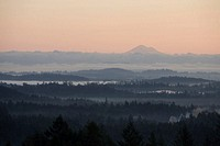 A foggy sunrise on Vancouver Island with Mt Baker in the distance