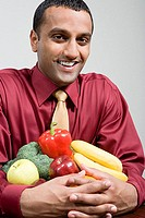Man holding fruit and vegetables