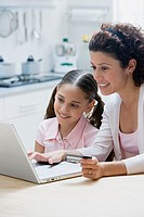 Mother and daughter online shopping