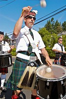 Comox Nautical Days Parade. Scottish Bagpipe band drummer. BC, Canada