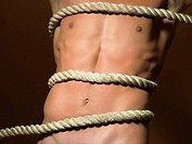 Rope tied around mans torso (thumbnail)