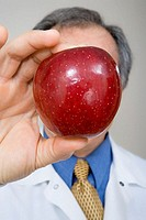 Dentist holding apple