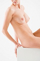 Naked woman sitting on a seat