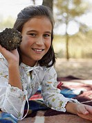 Girl holding a pine cone