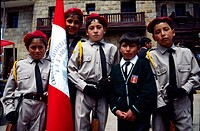 Young schoolchildren in military dress during the parade day. Huancavelica, Peru