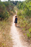 A Child walking in a path in Finale Ligure Italy