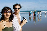 couple holidaying and taking snapshot on beach