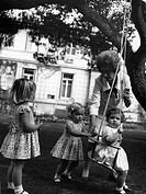 Frederika, 18 4 1917 - 6 2 1981, Queen Consort of Greece 1 4 1947 - 6 3 1964, with grandchildren Princess Alexia on the swing, Elena & Cristina of Bou...