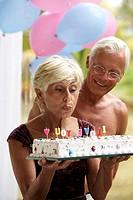 senior couple, birthday cake, happy, half portrait,