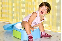 Potty training, three year old child sitting on a pot  Toilet training is usually started around the age of two when a child is able to control its bl...
