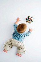Baby playing on a floor