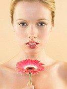Woman smelling a gerbera flower