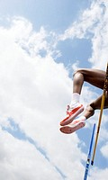 Athlete performing a high jump  This is a track and field event in which athletes must jump over a horizontal bar placed at measured heights  The athl...