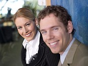 Businesswoman and businessman, smiling