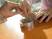 Business people assembling magnetic balls, close-up