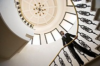 Businessman on spiral staircase