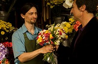 Man selling a bouquet of flowers