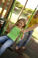 Father and Daughter in Park on swing (thumbnail)