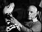 The artist Pablo Picasso 1881-1973 with his dog at La Californie, Cannes, in 1961