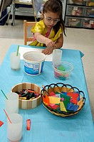A preschool child having fun tracing and coloring in nursery school
