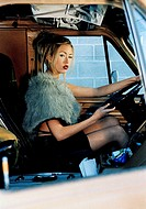 Motorist, miniskirt, fur-stole, gaze camera detail at the side, people, 30-40 years, woman, blond, made up, seriously, arrogantly, extravagantly, self...