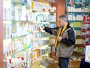 Pharmacy, shelves, customer, selects, care-product, no property release, pharmacy, stores, business, salesroom, trade, sale, health, people, man, 50-6...