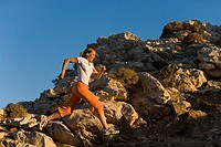 Jogs woman, cheerfully, jump, rocks, dusk people 30-40 years sportswoman athletically, sportswear, run-clothing, run-sport, runs, Jogging, sport, leis...