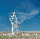 Woman standing in open space holding paint brush