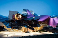 Ciudad del Vino, Herederos de Marques de Riscal winery building by Frank O. Gehry in the evening. Elciego, Rioja alavesa. Alava, Euskadi, Spain