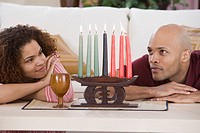 Couple looking at Kwanzaa candles
