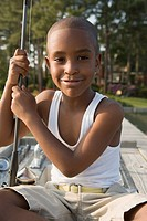 Little boy fishing on a dock, portrait