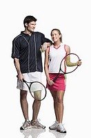 Couple holding tennis racquets