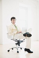 Smiling businessman sitting in chair