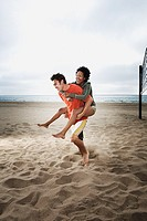 Playful couple on beach