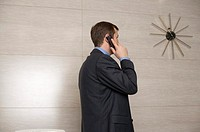 Businessman phoning with mobile phone