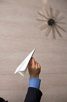 Businessman with paper airplane
