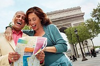 Couple Reading Map Outside Arc de Triomphe