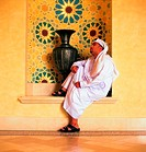 Pensive Arab man