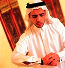 Arab man checking the time (thumbnail)