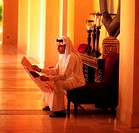 Arab businessman reading the newspaper
