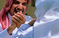 Arab men sharing a laugh
